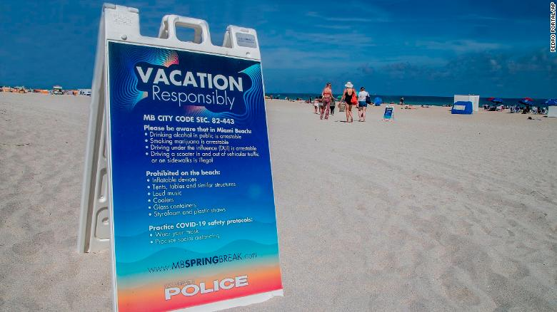 A sign on the beach earlier this month warns spring breakers to vacation safely.