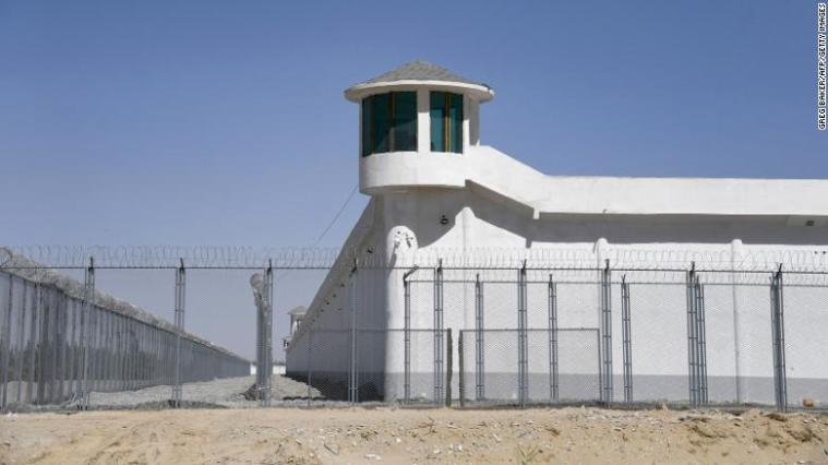 """This photo taken on May 31, 2019 shows a watchtower on a high-security facility near what is believed to be a re-education camp where mostly Muslim ethnic minorities are detained, on the outskirts of Hotan, in China's northwestern Xinjiang region. As many as one million ethnic Uighurs and other mostly Muslim minorities are believed to be held in a network of internment camps in Xinjiang, but China has not given any figures and describes the facilities as """"vocational education centres"""" aimed at steering people away from extremism."""