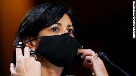 CDC Director Dr. Rochelle Walensky adjusts her mask during a Senate Health, Education, Labor and Pensions Committee hearing on Capitol Hill on March 18, 2021 in Washington, DC