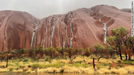 Multiple waterfalls tumble over the surface of Uluru, a UNESCO World Heritage site that saw rain totaling up to five times the March monthly average in just four days in some areas.