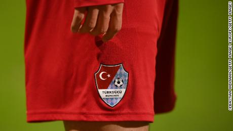 The club's logo is half-half of the Turkish and Bavarian flags