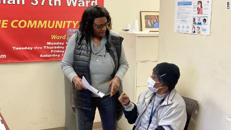 Councilor Emma Mitts, left, shares information about her experience with the COVID vaccine.  He also encourages his constituent, Bernice Hillman, 77, to get vaccinated.