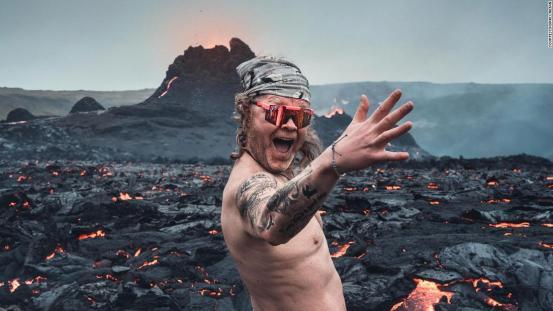Icelandic man naked next to erupting volcano