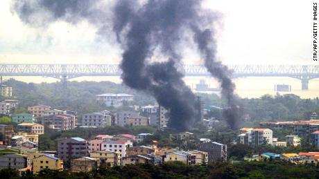 Smoke rises over Thaketa Township in Yangon on March 27, 2021, as security forces continue to crack down on protests against the military coup.