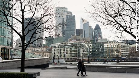 People walk on empty street in London's popular South Bank district last Wednesday.