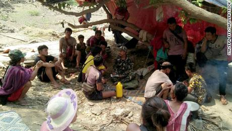 Ethnic Karen villagers fleeing from air attacks by Myanmar military take rest in a jungle after crossing the Myanmar-Thai border in Mae Hong Son province, Thailand, on March 28.