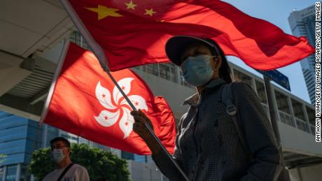 Pro-Beijing supporters gather outside Hong Kong's Legislative Council on November 12, 2020.