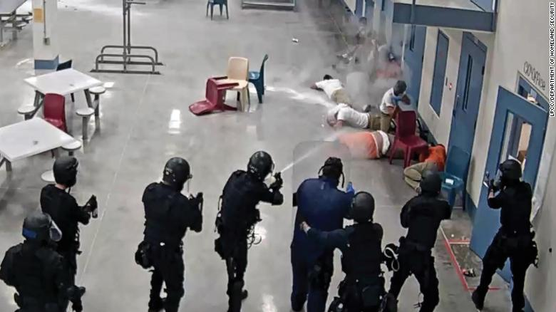 In this image from video surveillance footage, provided by La Palma Correctional Center staff and released in the DHS report, LPCC staff are seen firing pepper spray and chemical agents at detainees in an LPCC housing area on April 13, 2020.