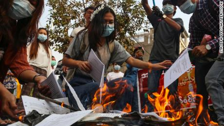 Demonstrators burn a copy of Myanmar's constitution during a protest against the military coup in Mandalay, Myanmar, on April 1.