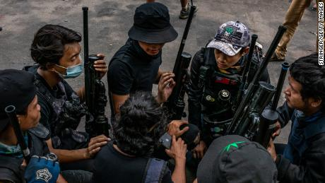 Anti-coup protesters hold improvised weapons during a protest in Yangon on April 3, in Yangon, Myanmar.