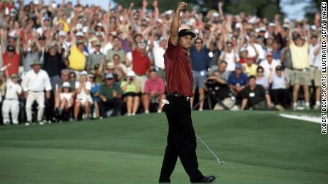 Woods celebrates after winning the 2001 Masters.