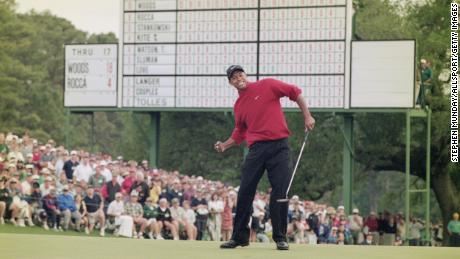 Woods celebrates after sinking a four-foot putt to win the 1997 Masters.