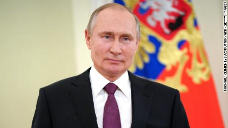 Putin signs law allowing him to run for two more terms