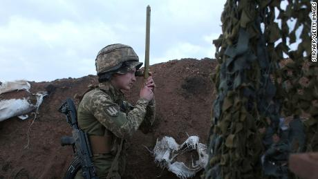 A Ukrainian serviceman uses a periscope in a trench on the frontline with Russia-backed separatists near the town of Zolote, in the Lugansk region on April 8.