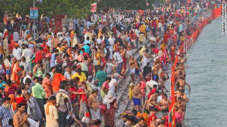 Hindu devotees take a holy dip in the Ganges River in Haridwar, India on 12 April.