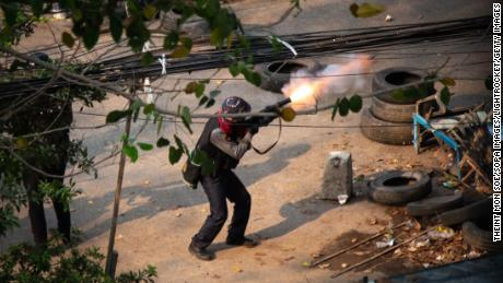 Myanmar police seen shooting a 38 mm grenade launcher at  protesters during a demonstration against the military coup.