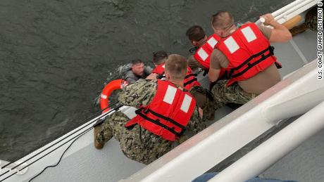 Crew members on the US Coast Guard cutter Glenn Harris  pulls a person from the water after the commercial liftboat Seacor Power capsized on Tuesday April 13.