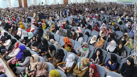Afghan women, youths, activists and elders gather at a rally to support peace talks and the republic government in Kabul, Afghanistan, on March 29, 2021.