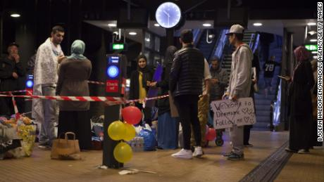 A small group of people in Copenhagen Central Station wait to welcome Syrian refugees on September in 2015.
