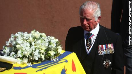Prince Charles walks behind his father's coffin during the procession.