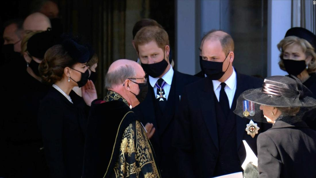 Princes William and Harry walk together after grandfather's funeral