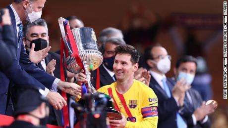 Lionel Messi of FC Barcelona lifts the trophy after winning the Copa Del Rey Final match between Athletic Club and Barcelona at Estadio de La Cartuja on April 17, 2021 in Seville, Spain.