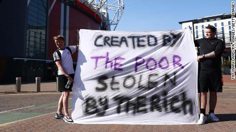 Football fans opposing the European Super League outside Old Trafford in Manchester.