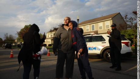 Hazel Bryant is embraced after her teen niece, Ma'Khia Bryant, was shot and killed in a fatal police shooting on Tuesday in Columbus, Ohio.