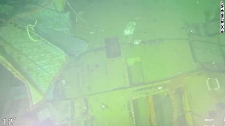 A rescue ship from Singapore sent a remote operated vehicle to get clearer underwater visual imagery of the sub.