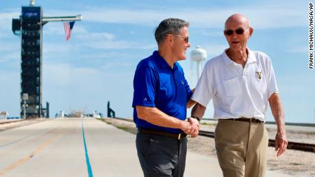 Collins, right, speaks to Kennedy Space Center Director Bob Cabana at Launch Complex 39A, about the moments leading up to Apollo 11 launch 50 years later on July 16, 2019.