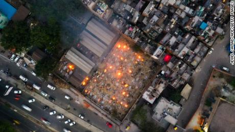 In this aerial picture taken on April 26, burning pyres of victims who lost their lives due to Covid-19 are seen at a cremation ground in New Delhi.