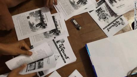 This screengrab provided via AFPTV video footage taken on April 10, 2021 shows an underground newsletter being produced to spread information in Yangon.