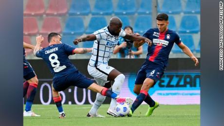 Crotone's Luca Cigarini, left, Inter Milan's Romelu Lukaku, center, and Crotone's Lisandro Magallan compete for the ball. Lukaku has scored 21 goals in Serie A this season.