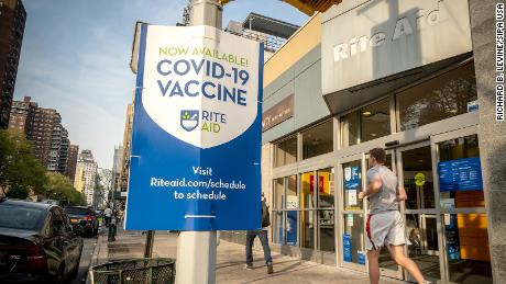 A sign in front of a Rite Aid drugstore in New York advertises the availability of the Covid-19 vaccine.