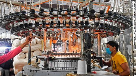 Labourers work in a Hosiery mill in Kolkata on February 1, 2021.