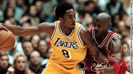 Bryant controls the ball against Jordan on February 1, 1998.