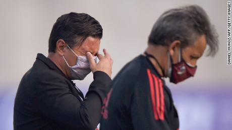 River Plate coach Marcelo Gallardo reacts to tear gas thrown outside the stadium.