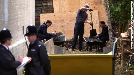 Police sift through soil as they search for clues in the Fred West murder cases in the garden of 25 Midland Road, Gloucester, on April 27, 1994.