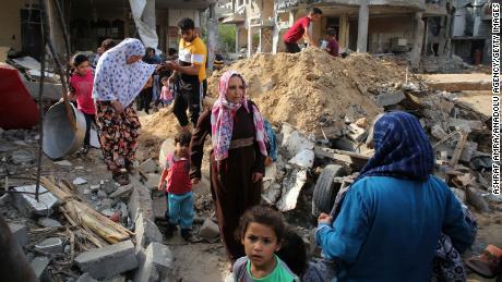 Palestinians return Friday to homes that were destroyed by Israeli airstrikes in Beit Hanoun, Gaza.