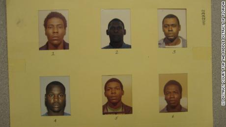 Attorneys question why Green's mug shot was so much smaller and darker than the others.