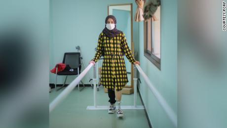 Weam Elastal learning how to use her new prosthetic leg.