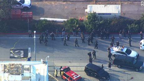 Law enforcement officers gather near the site of a reported shooting in San Jose, California, on Wednesday.
