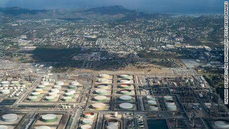 A Caribbean island bet its future on petrochemicals. Then oil rained down on homes.
