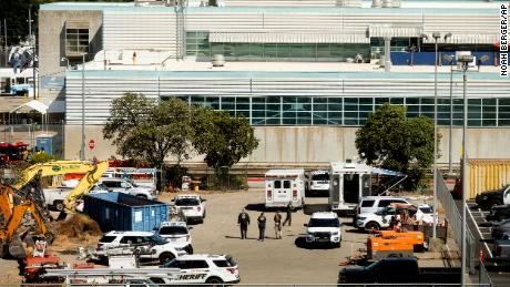 Law enforcement officers respond to the scene of a shooting at a Santa Clara Valley Transportation Authority facility on May 26, 2021, in San Jose, Calif.