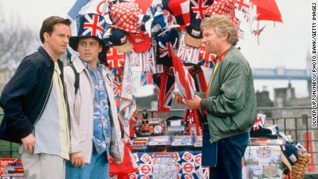 """Matthew Perry and Matt LeBlanc shoot a """"Friends"""" scene with Richard Branson in the London episode. Stevens told CNN that the scene was shot on a roof, with hoards of fans below. """"We were 100% surrounded by fans, it was like a mob scene,"""" he said."""