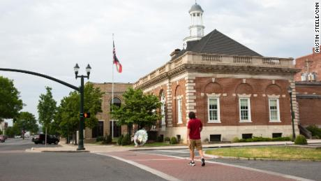 A man walks by the Greater Dalton Camber of Commerce.