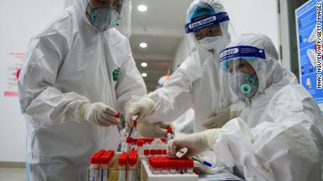 Health workers collect swab samples to test for Covid-19 at the Thanh Xuan district medical centre in Hanoi on May 15.
