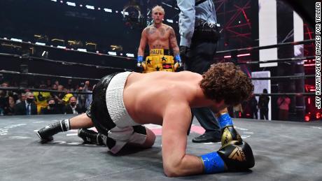 Jake Paul stands above Ben Askren after taking down the former MMA fighter.