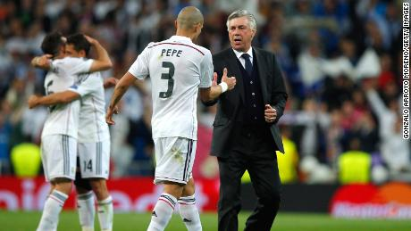 Pepe celebrates victory with Ancelotti following the return of the UEFA Champions League quarter-finals against Atletico Madrid.