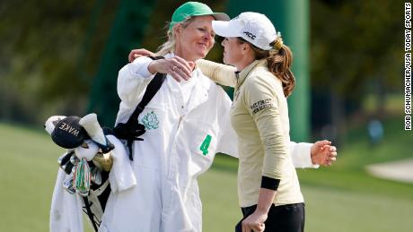 Migliaccio his caddy and mother, Ulrika after losing in the first playoff hole against Tsubasa Kajitani during the women's national amateur tournament in Augusta.
